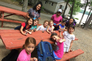 children at picnic table - Camp Hadar - Jewish day camp - New England